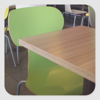 Wooden tables and chairs with furiture in restaura square sticker