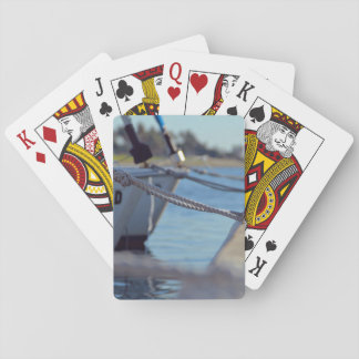 Wooden Themed, Several Boats Knotted To A Dock Wit Playing Cards