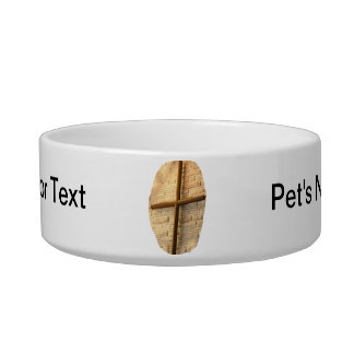 Wooden thin cross on white brick church wall bowl