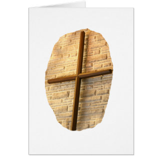 Wooden thin cross on white brick church wall stationery note card