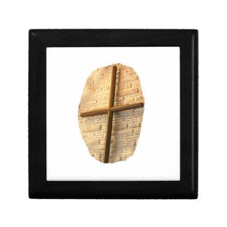 Wooden thin cross on white brick church wall jewelry box