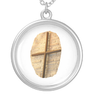 Wooden thin cross on white brick church wall pendant