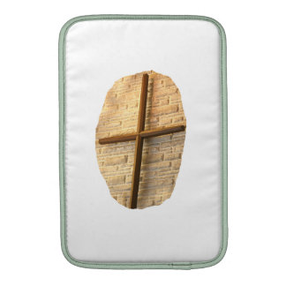 Wooden thin cross on white brick church wall sleeve for MacBook air