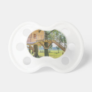 Wooden tree house in oak tree with grass pacifier