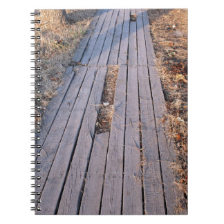 Wooden walkway made of planks spiral notebook