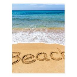 Word Beach written in sand at greek sea Postcard