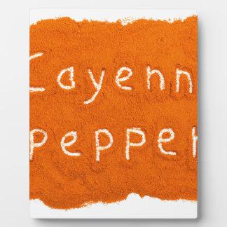 Word Cayenne pepper written in powder Plaque