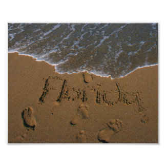 Word Florida in beach sand with wave coming Photograph
