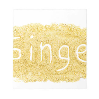 Word Ginger written in spice powder Notepad