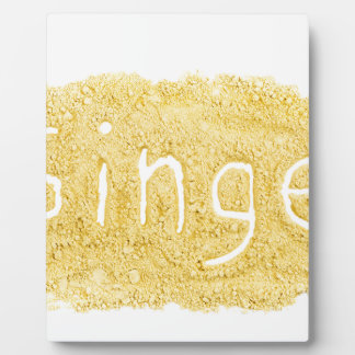 Word Ginger written in spice powder Plaque