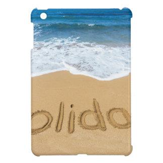 Word holiday written in sand on beach iPad mini covers