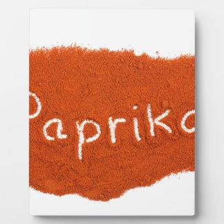 Word paprika written in paprika powder plaque