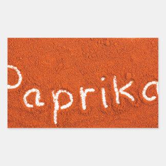 Word paprika written in paprika powder rectangular sticker