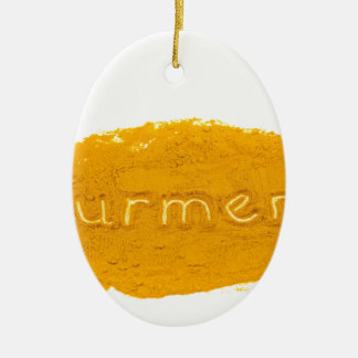 Word Turmeric written in powder on white backgroun Ceramic Ornament
