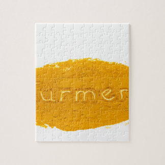 Word Turmeric written in powder on white backgroun Jigsaw Puzzle