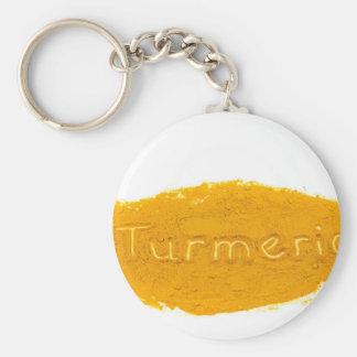 Word Turmeric written in powder on white backgroun Keychain