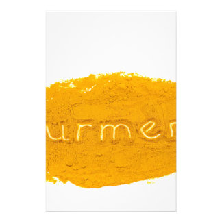 Word Turmeric written in powder on white backgroun Stationery