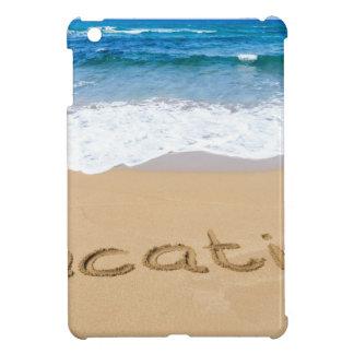 word vacation written on sand beach at sea iPad mini cases