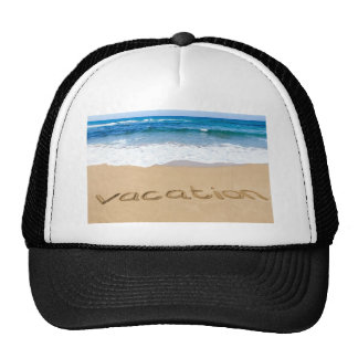 word vacation written on sand beach at sea trucker hat