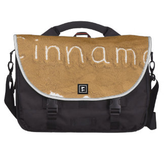 Word written in Cinnamon powder on white backgroun Laptop Bag
