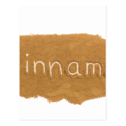 Word written in Cinnamon powder on white backgroun Postcard