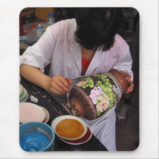 Worker at chinese fajance factory mouse pad