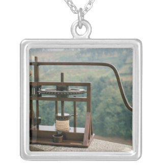 Working model of an olive press silver plated necklace