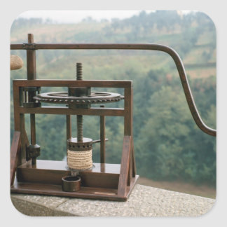 Working model of an olive press square sticker