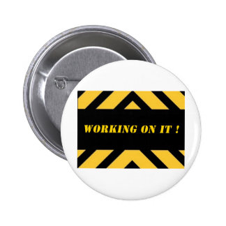 workingonitbig.jpg pinback button