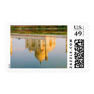 World famous Taj Mahal temple reflection at Postage