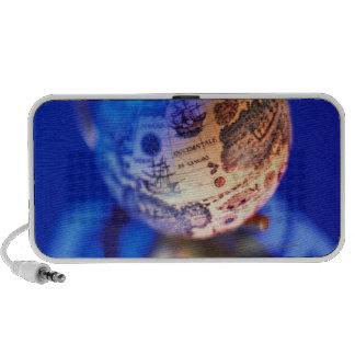 World globe atop recycling symbol portable speaker