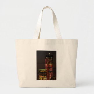 World Trade Center lit up in Red Close Up Tote Bags