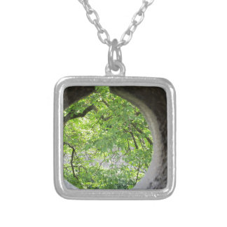 World view through hole silver plated necklace