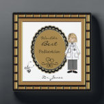 "World&#39;s Best Doctor Female Plaque<br><div class=""desc"">Personalize this plaque for your favorite female doctor.. Just use the customize button to edit the text in the easy Zazzle text editor. Cute image features a woman in a medical coat with a stethoscope accent. Male version also available. See our many other occupation title designs in our Monograms and...</div>"