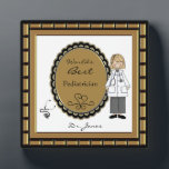 """World&#39;s Best Doctor Female Plaque<br><div class=""""desc"""">Personalize this plaque for your favorite female doctor.. Just use the customize button to edit the text in the easy Zazzle text editor. Cute image features a woman in a medical coat with a stethoscope accent. Male version also available. See our many other occupation title designs in our Monograms and...</div>"""