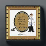 "World&#39;s Best Veterinarian Male Plaque<br><div class=""desc"">Personalize this plaque for your favorite male veterinarian or pet care technician. Just use the customize button to edit the text in the easy Zazzle text editor. Cute image features a male doctor holding a cat, with a paw print accent. Female version also available. See our many other occupation title...</div>"