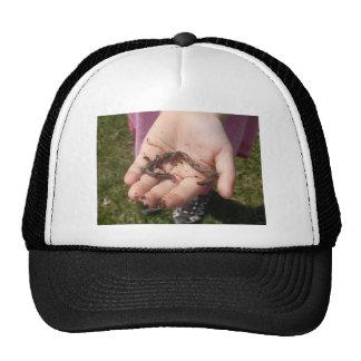 worms in hands trucker hat