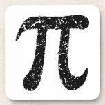 Worn distressed black pi symbol coaster