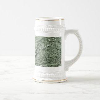 Worn green leaf beer stein