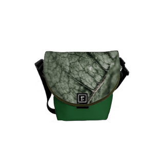 Worn green leaf messenger bag