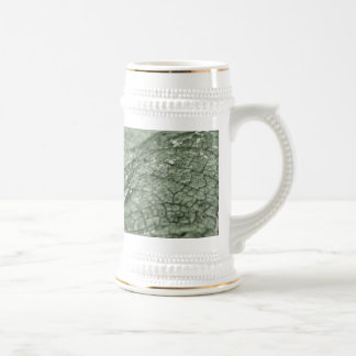 Worn green leaf coffee mugs