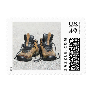Worn leather hiking boots postage