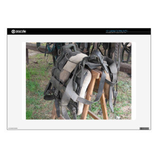 Worn leather horse bridles and bits laptop skins