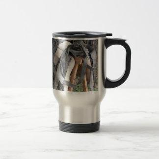 Worn leather horse bridles and bits travel mug