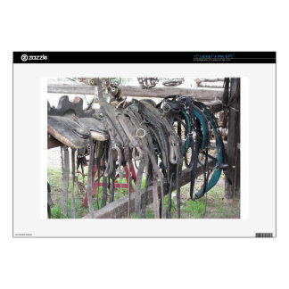 """Worn leather horse bridles hanging on wooden fence decals for 15"""" laptops"""