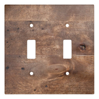 Worn pine board light switch cover