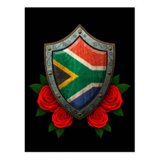 Worn South African Flag Shield with Red Roses Postcard