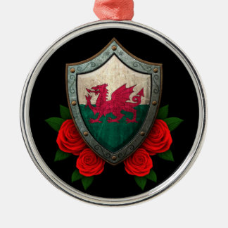 Worn Welsh Flag Shield with Red Roses Round Metal Christmas Ornament