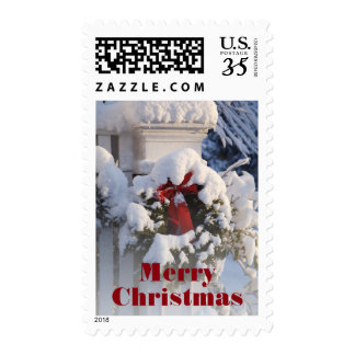 Wreath covered in snow postage