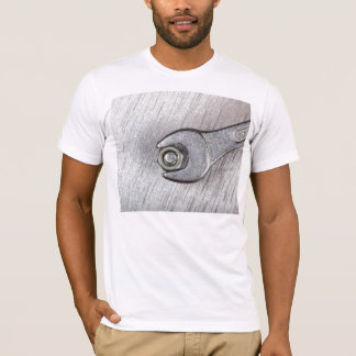 Wrench, bolt and nut on metal surface T-Shirt